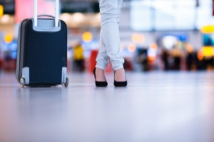 Pretty young female passenger at the airport (shallow DOF; color